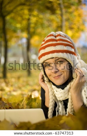beautiful sexy woman portrait working on laptop computer in natural autumn outdoors