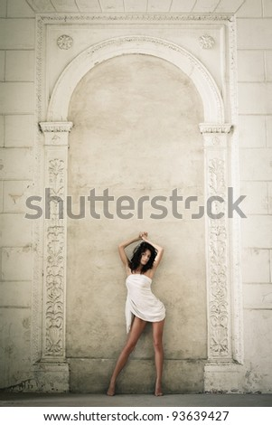Beautiful sexy woman posing in a castle interior - stock photo
