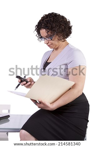 Beautiful Sexy Woman Sitting on the Desk at Work - stock photo