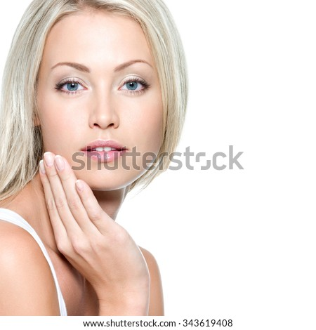Beautiful sexy woman touching her health face - isolated - stock photo