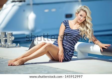 stock photo beautiful sexy woman wearing sailor striped dress posing at the sea 145912997