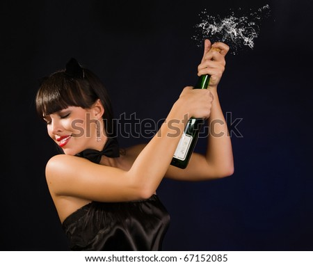 Beautiful sexy woman with a champagne bottle - stock photo