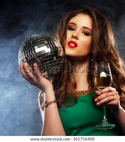 Beautiful sexy woman with a glass of white wine - stock photo