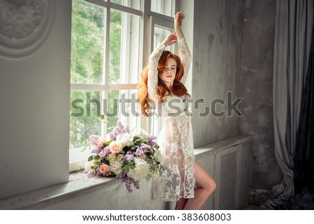 beautiful sexy woman with flowers in the morning