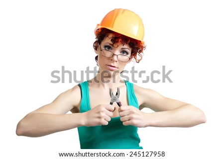 Beautiful sexy woman with red hair posing in the construction helmet on a white background - stock photo