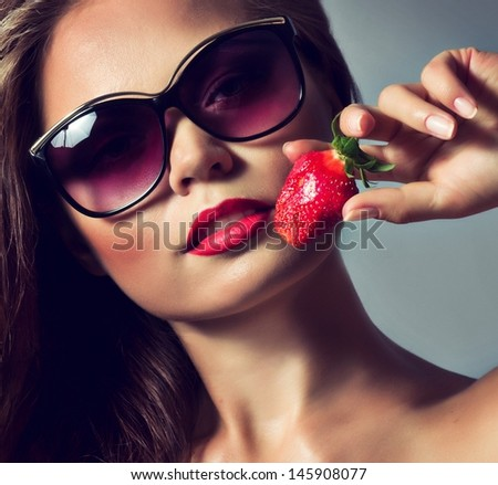 Beautiful sexy woman with strawberry