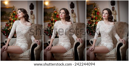 Beautiful sexy woman with Xmas tree in background sitting on elegant chair in cozy scenery. Portrait of girl posing pretty with short tight fit white dress. Attractive brunette female, indoor shot. - stock photo