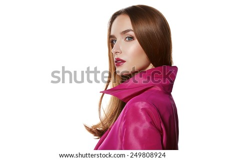 Beautiful sexy young blond girl with long hair bright evening make-up red lips long fluffy eyelashes in pink cloak joy fun beauty salon clothes shop - stock photo
