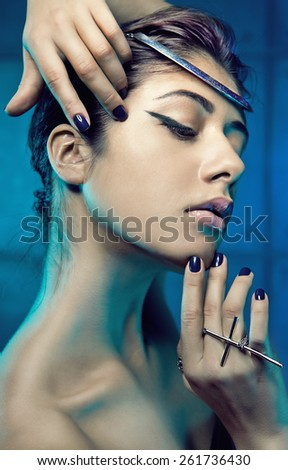 Beautiful sexy young brunette woman with beautiful face and sexy lips. Portrait of a pretty fashion makeup model posing at studio. - stock photo