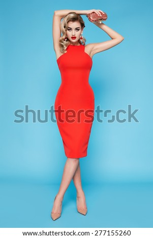 Beautiful sexy young business woman blond hair with evening make-up wearing a dress suit top and high-heeled shoes  business clothes for meetings and walks autumn collection perfect body shape - stock photo