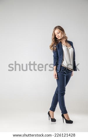 Beautiful sexy young business woman with evening make-up dressed in pants and suit business clothes for meetings and walks - stock photo