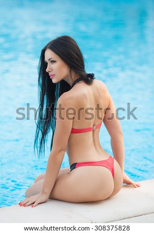 beautiful sexy young girl with perfect slim figure with long wet hair