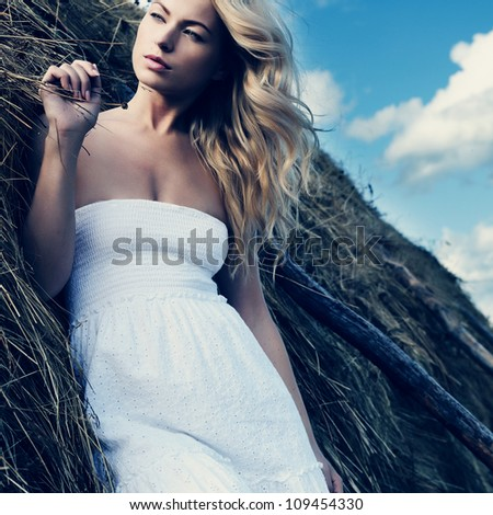 Beautiful sexy young near a haystack - stock photo