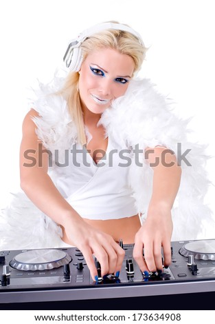 Beautiful Sexy Young Woman as DJ playing music on (pickup) mixer. Isolated on a white background. Studio shot - stock photo