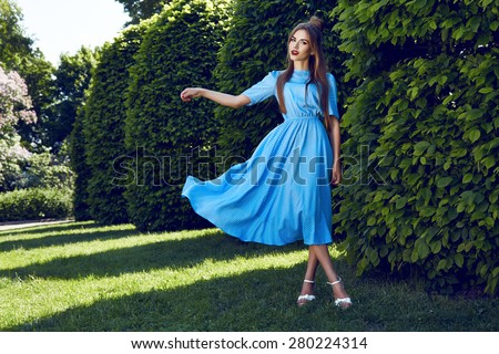 Beautiful sexy young woman brunette hair evening makeup wearing short dress suit top  skirt high heels shoes business clothes meeting walks summer fall collection perfect in park sun shine body shape - stock photo