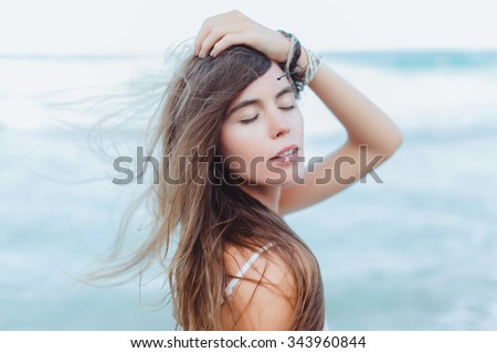 Beautiful sexy young woman brunette hair evening makeup wearing short dress suit top skirt,tropical island LA,California.walks summer fall collection,perfect outfit in ocean view, sun shine body shape - stock photo