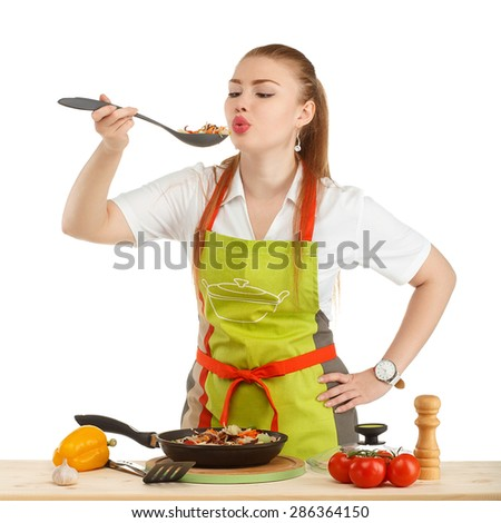 Beautiful sexy young woman cooking fresh meal isolated on white background - stock photo