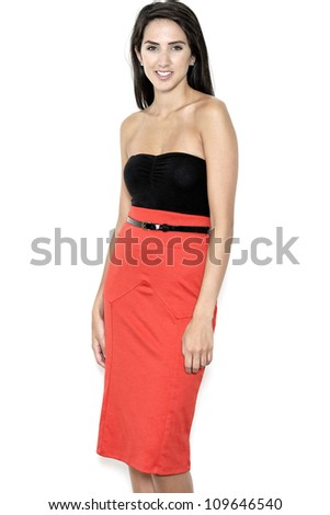 Beautiful sexy young woman in red pencil skirt - stock photo