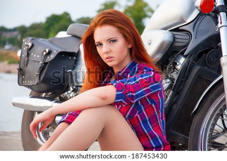 Beautiful, sexy, young woman on a motorcycle.