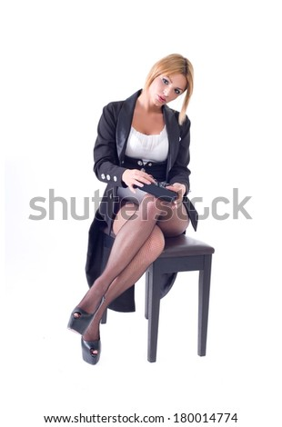 Beautiful sexy young woman posing with audio equipment. Isolated on a white background. Studio shot  - stock photo