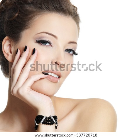 Beautiful sexy young woman with black manicure and stylish hairstyle posing on white background
