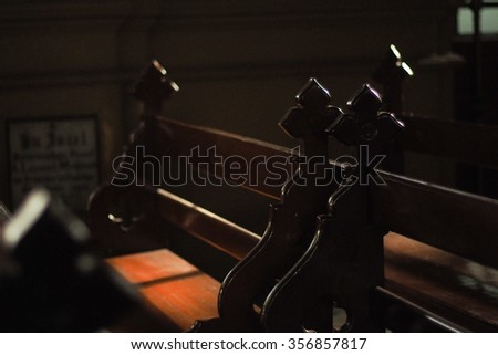 beautiful shadow lied down on the wood pews in a church :close up shot on selective focus