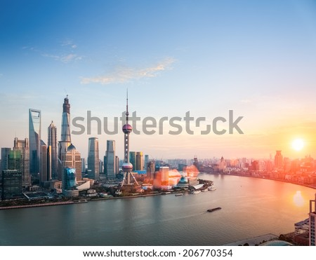 beautiful shanghai at dusk ,  huangpu river and financial district skyline in sunset  - stock photo