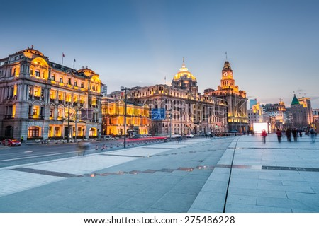 beautiful shanghai bund in nightfall, excellent historic buildings in the brilliantly illuminated - stock photo