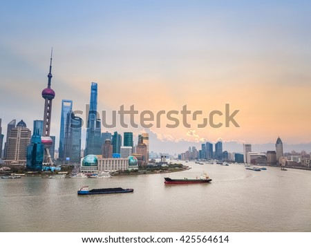 beautiful shanghai cityscape in sunset, huangpu river and pudong skyline, China