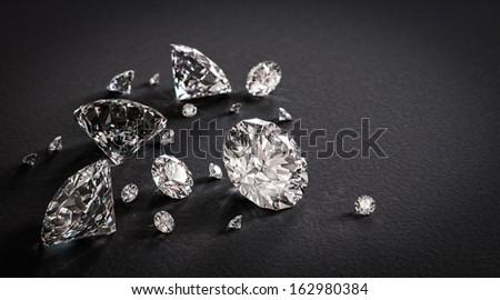 Beautiful shiny diamonds on black background - stock photo