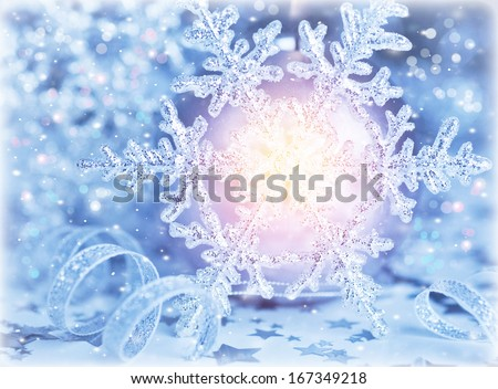 Beautiful shiny snowflake with bright light in centerpiece, festive Christmastime background, holiday greeting card, wintertime ornament - stock photo