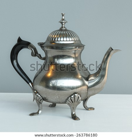 Beautiful Shiny Vintage Metal Coffee Pot On White Table And Grey Background