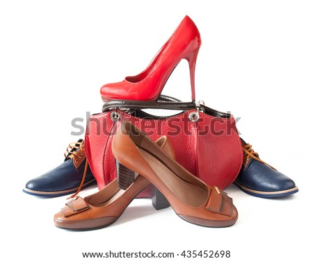 Beautiful shoes and bag isolated on white background