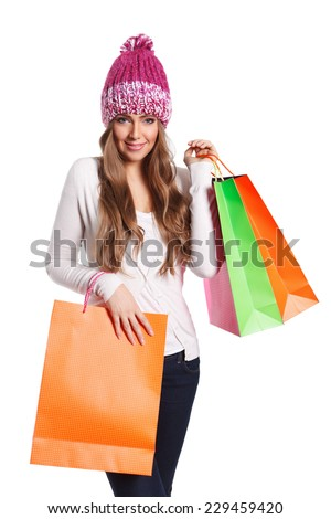 Beautiful shopper woman with paper bags on white background
