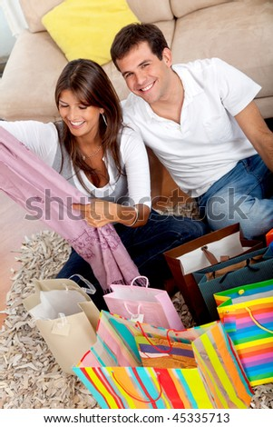Beautiful shopping couple at home with purchases