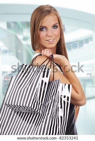 Beautiful shopping woman at  mall - stock photo