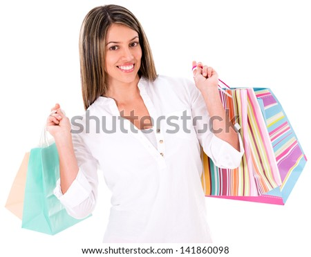 Beautiful shopping woman holding bags - isolated over white