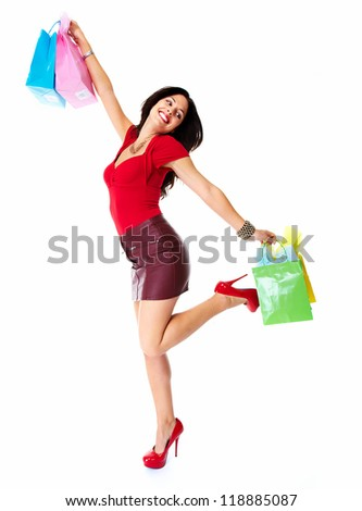 Beautiful shopping woman. Isolated on white background.