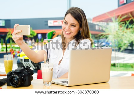 Beautiful shopping woman taking selfie at the shopping mall - stock photo