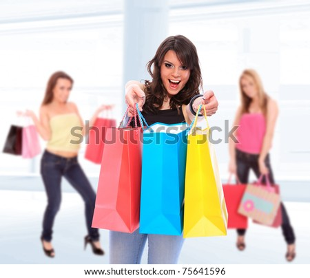 Beautiful shopping women with colorful bags