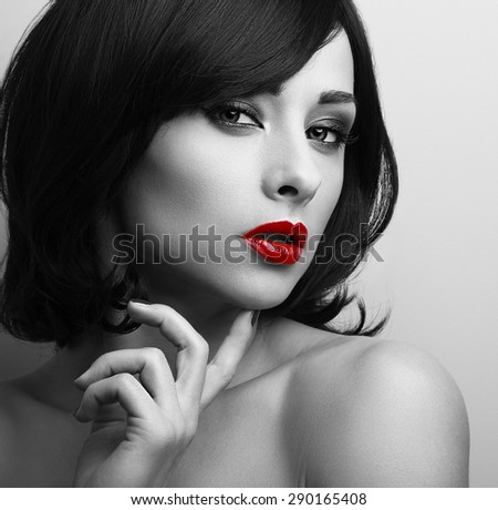 Beautiful short hair style woman with red lips looking sexy. Black and white contrast closeup portrait  - stock photo