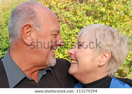 Beautiful shot of a senior couple looking into each others eyes - stock photo
