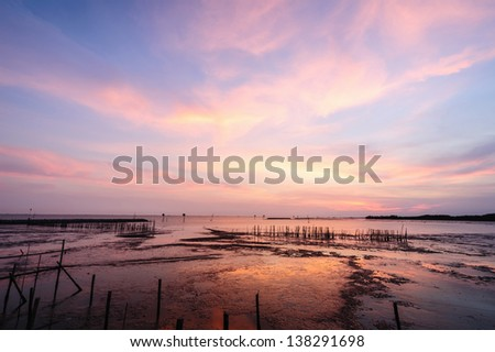 Beautiful silhouette sunset at tropical sea - stock photo