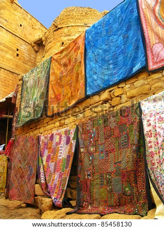 "Beautiful silks and textile handcrafts at the fort of Jaisalmer, the magnificent ""Golden City"" in the heart of Rajasthan (India), surrounded by the desert of Thar. - stock photo"