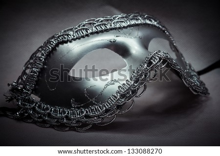 Beautiful Silver Fantasy Mask In The Dark - stock photo