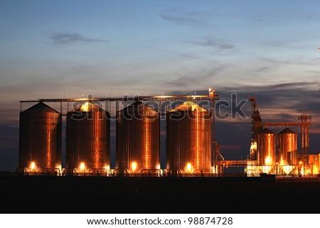 beautiful silver silos in landscape - stock photo