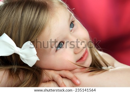 beautiful, sincere, cheerful, children's emotions of a beautiful little girl - stock photo