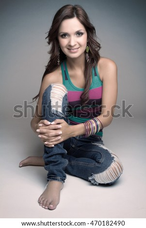 Beautiful sitting young woman smiling