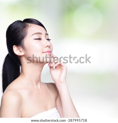 Beautiful Skin care woman Face smile and enjoy carefree isolated on nature green background. asian Beauty - stock photo