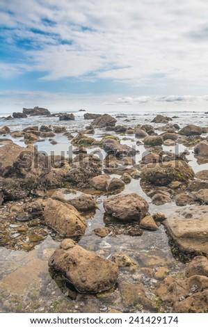 Beautiful sky and beach in Laguna Beach, California - stock photo